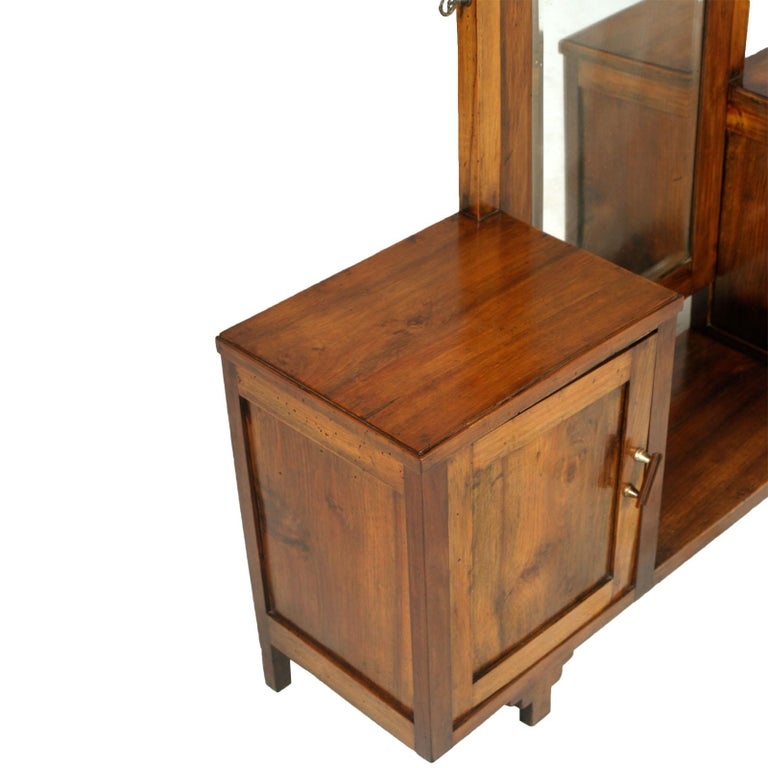 Italian 1920s country entry cabinet or mirrored vanity in solid blond walnut, restored and wax polished. Original bevelled mirror.  Measures cm: H 138/54, W 128, D 31.