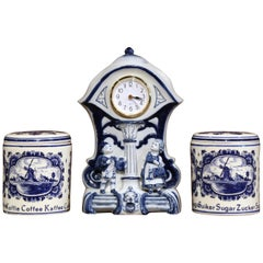 Early 20th Century Dutch and German Three-Piece Delft Canisters and Clock