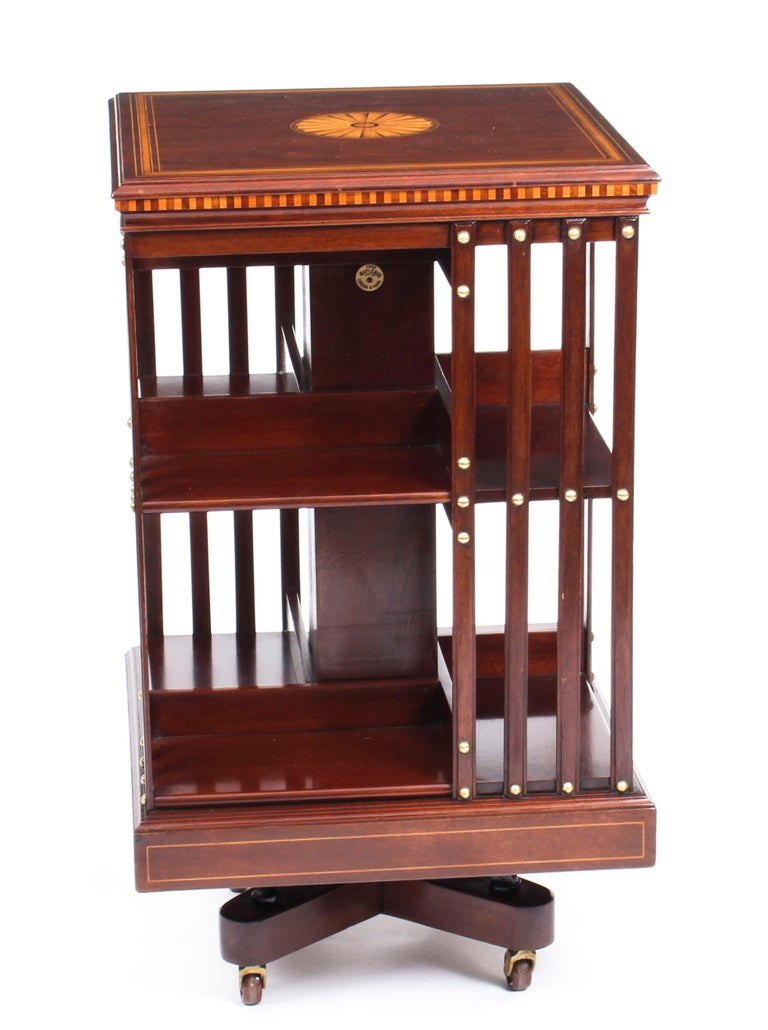 This an exquisite antique revolving bookcase by the renowned Victorian retailer and manufacturer Maple & Co., circa 1900.