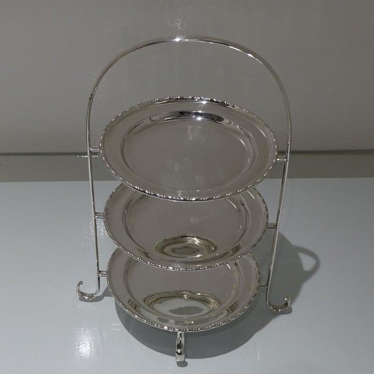 A highly desirable three tier cake stand designed with an elegant wire frame and three inner detachable plates. The plates are plain formed in design but have a stylish outer border for highlights.     Measures: Height 15.7 inches/40cm  Width