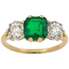 Early 20th Century Emerald and Diamond Three-Stone Ring