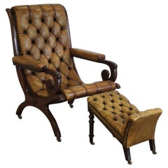 Early 20th Century English Library Armchair and Foot Stool
