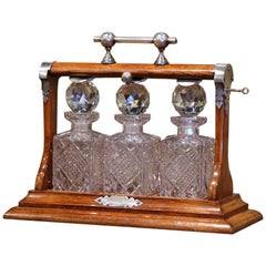 Early 20th Century English Oak and Chrome Tantalus with Cut-Glass Decanters