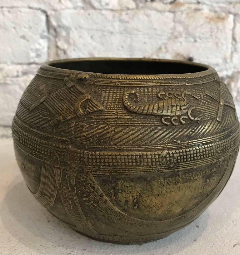 Early 20th century Dhorkra Measuring Bowl from Orissa, India    Measures: Bowl is 4 inches height x 5.5 inches diameter. The base is 3.25 inches diameter and the opening is 3.75 inches diameter.