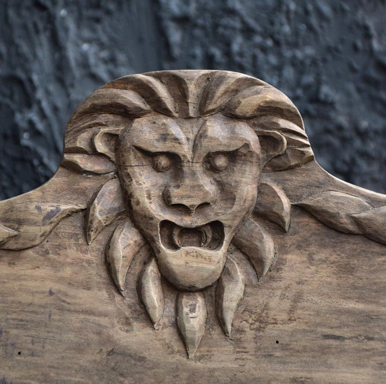 Early 20th century folk art carved oak lion panel.