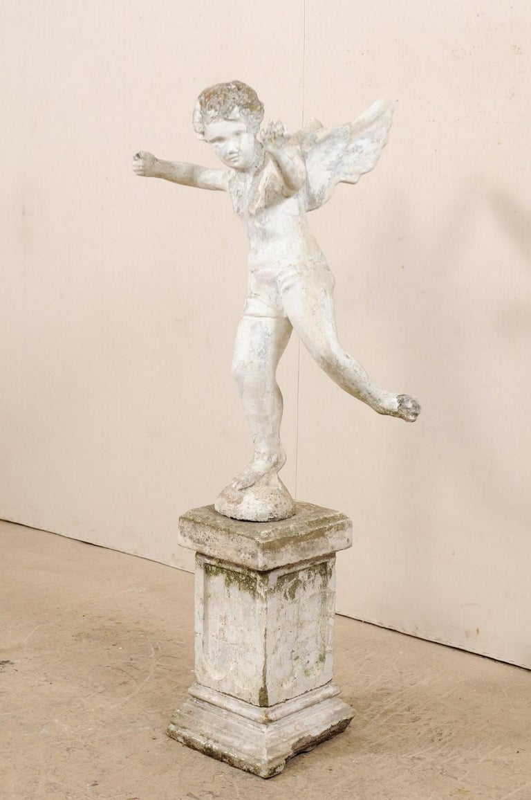 Concrete Early 20th Century French Antique Cupid Garden Statue For Sale