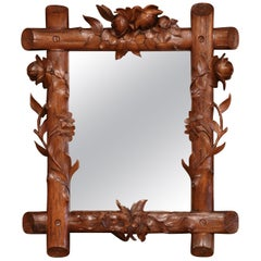 Early 20th Century French Black Forest Carved Walnut Wall Mirror