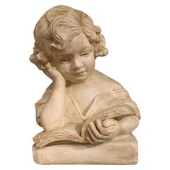 Early 20th Century French Carved Patinated Stone Bust of Young Girl Reading