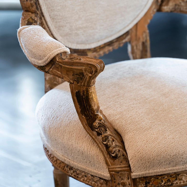 Early 20th century French carved wood armchair in perfect condition and vintage patina, newly reupholstered in ivory velvet.