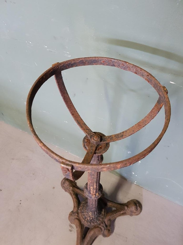 Antique French cast iron stand with half-spherical holder, here used to be a tin ashtray holder and stood on the terrace, furthermore in good condition but weathered. Originating from circa 1900.  The measurements are, Depth 43 cm/ 16.9