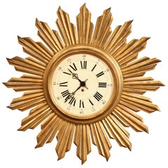 Early 20th Century French Giltwood Wall Sunburst Clock in Good Working Order