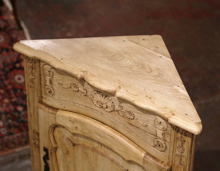 Patinated Early 20th Century French Louis XV Carved Oak Corner Cabinet from Normandy For Sale