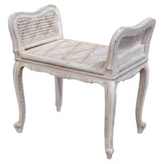 Early 20th Century French Louis XV Carved Painted Bench with Cane Seating