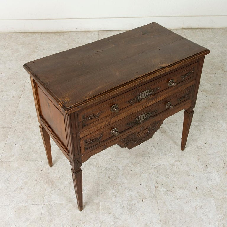 This early 20th century French Louis XVI style ash commode sauteuse or