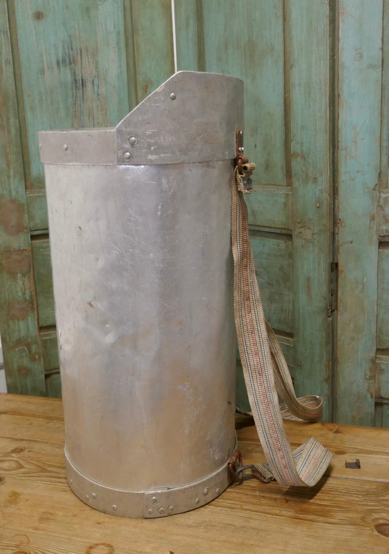 Early 20th century French olive picker's hod.  A French olive picker's Hod from the South of France, this galvanized riveted hod would have been worn on the back of the picker. It is in good used condition and has canvas back straps The hod is