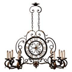 Early 20th Century French Painted and Gilt Iron Ten-Light Clock Chandelier