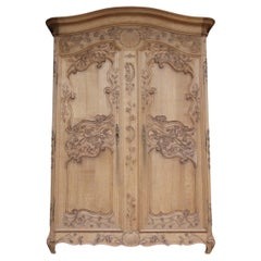 Early 20th Century French Provincial Armoire in Stripped Oak