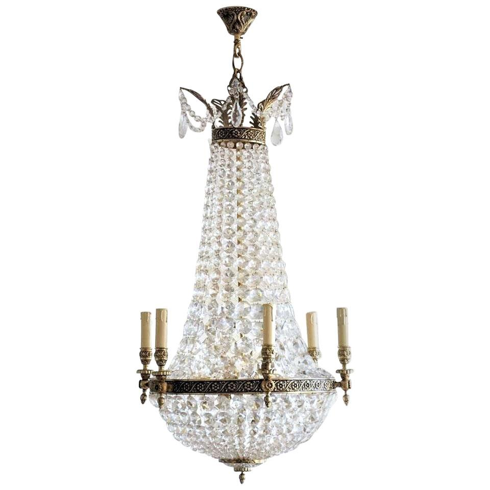 Early 20th Century French Regency Bronze Crystal Twelve-Light Chandelier