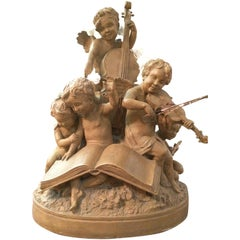 Early 20th Century French Terracotta Musician Angels Statue Signed Delaspre
