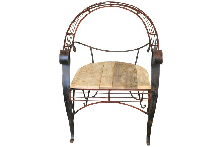 A charming early 20th century Garden chair from the South of France. Soundly constructed from well patina'd painted iron and wooden seat. A terrific accent piece for any garden or interior.