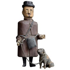 Early 20th Century German Carved Figure of a Man and His Dog