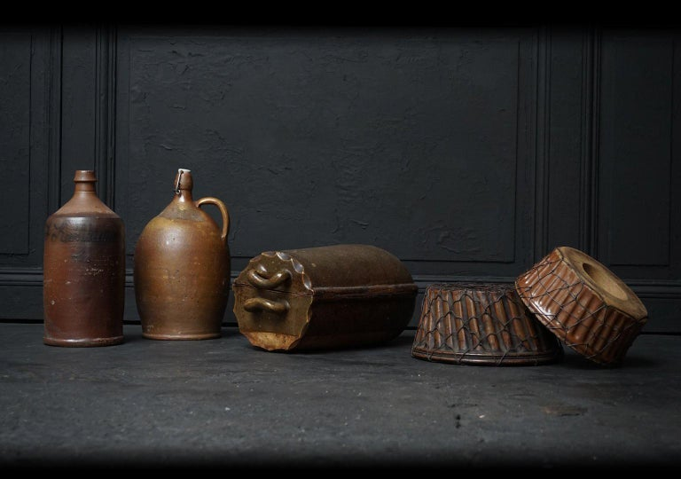Lovely set of five antique German Earthenware kitchen objects.  You see two large beer bottles or jugs. Two Gugelhupf moulds (or Kouglof) for baking cake. Both moulds are visibly mended in a very decorative way. And a real old fashioned Römertopf to