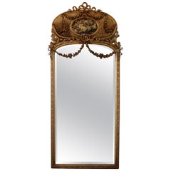 Early 20th Century Giltwood Carved Roses and Cane Trumeau Mirror