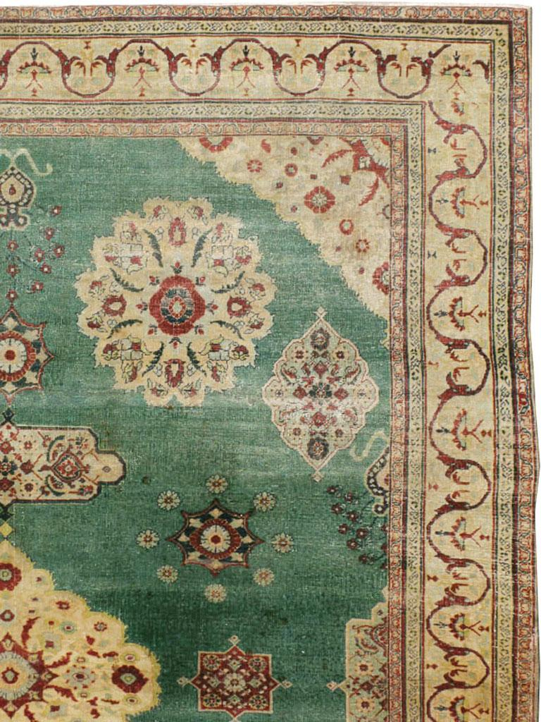 Victorian Early 20th Century Green, Red, and Beige Distressed Rug For Sale