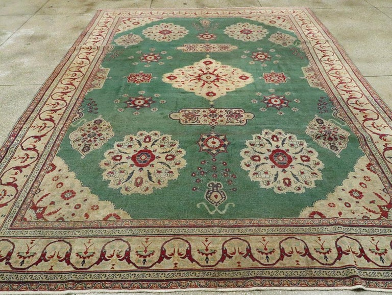 Hand-Knotted Early 20th Century Green, Red, and Beige Distressed Rug For Sale