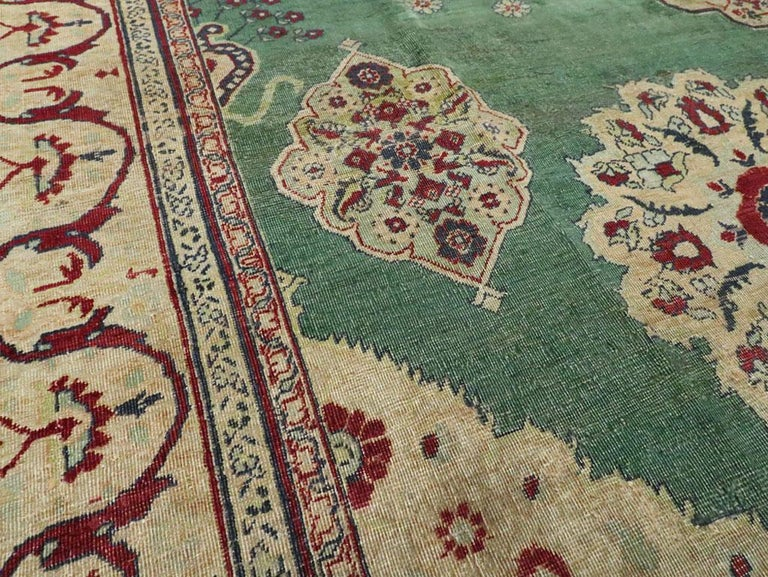 Early 20th Century Green, Red, and Beige Distressed Rug In Fair Condition For Sale In New York, NY