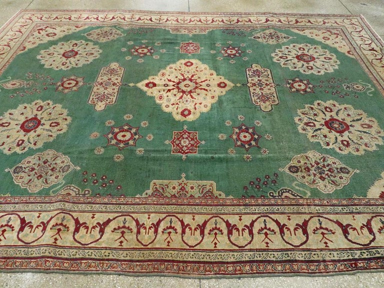 Early 20th Century Green, Red, and Beige Distressed Rug For Sale 1