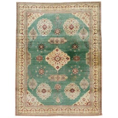 Early 20th Century Green, Red, and Beige Distressed Rug