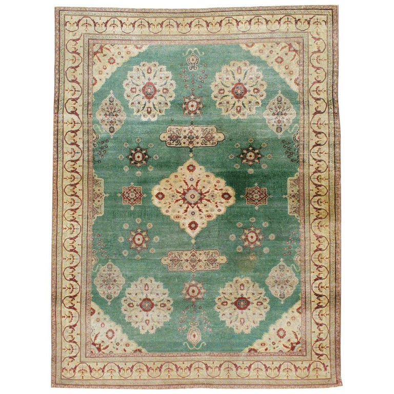 Early 20th Century Green, Red, and Beige Distressed Rug For Sale