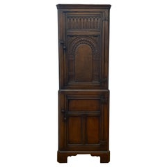 Early 20th Century Hand Carved English Oak Corner Cabinet