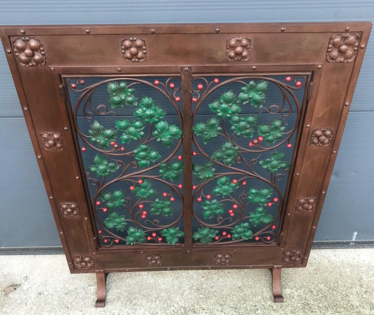 Highly decorative and all handcrafted, ironwork fire screen.  We can think of more than one way to use this fantastically decorative screen. Around the turn of the century it would have been made to Stand in front of the fireplace in the warmer part