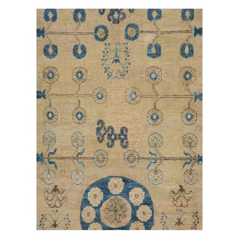 An antique East Turkestan Khotan gallery format carpet handmade during the turn of the 20th century.  Measures: 7' 2