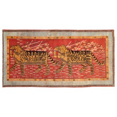 Early 20th Century Handmade East Turkestan Khotan Gallery Rug of Two Tigers
