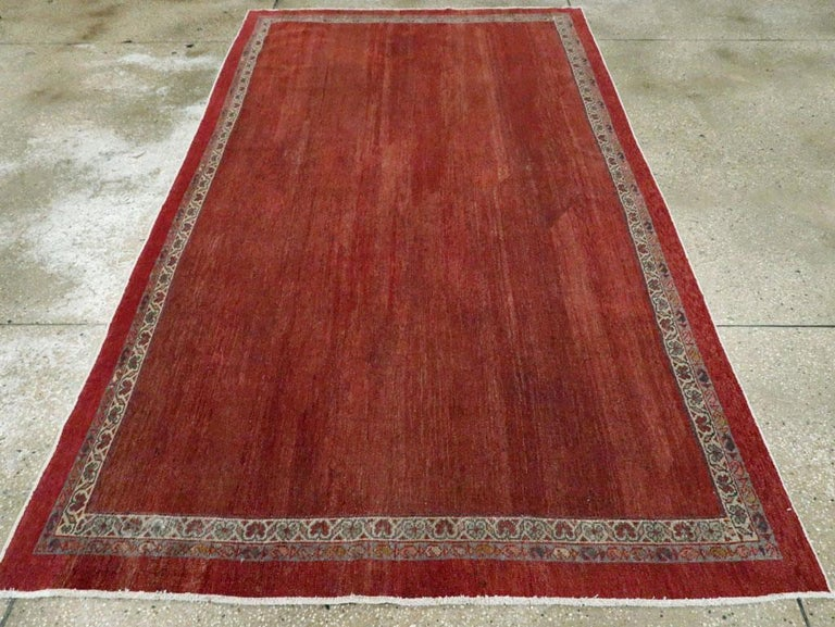 Early 20th Century Handmade Persian Rust Red Open Field Accent Rug In Good Condition For Sale In New York, NY