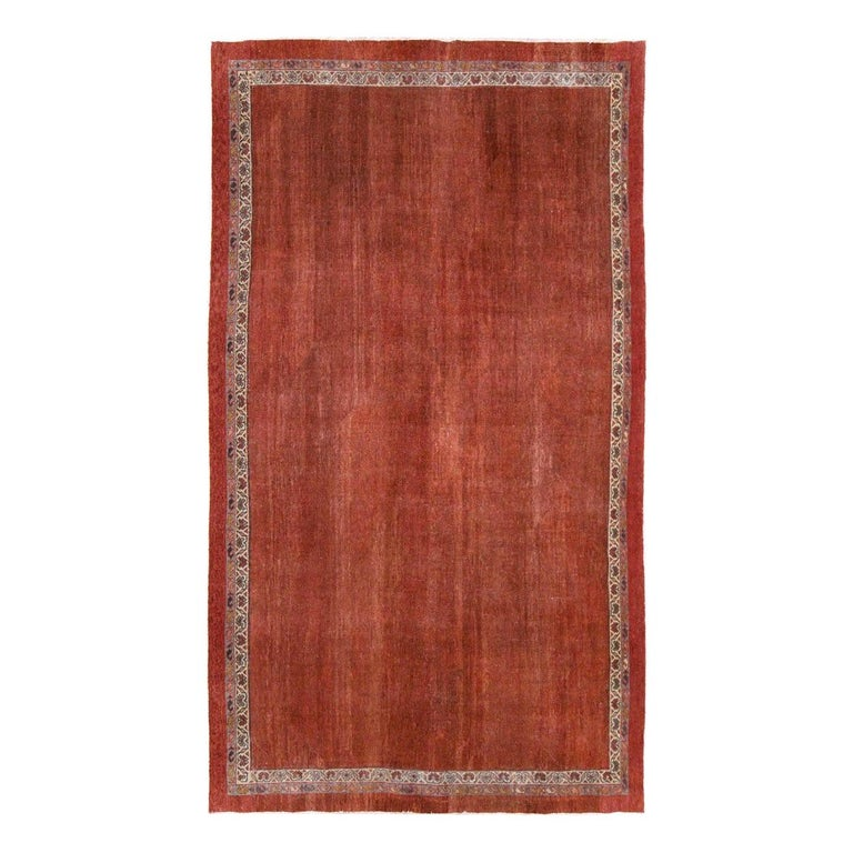 Early 20th Century Handmade Persian Rust Red Open Field Accent Rug For Sale