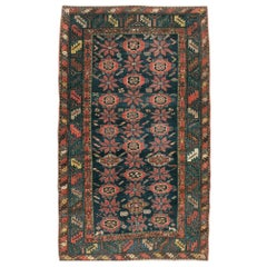 Early 20th Century Handmade Persian Accent Rug in Dark Blue, Green and Light Red