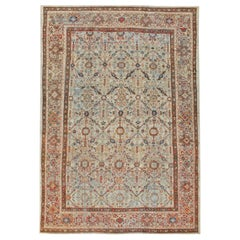 Early 20th Century Handmade Persian Room Size Rug in Light Grey, Beige, and Rust