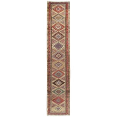 Early 20th Century Handmade Persian Runner with Brown, Green, and Rust Tones