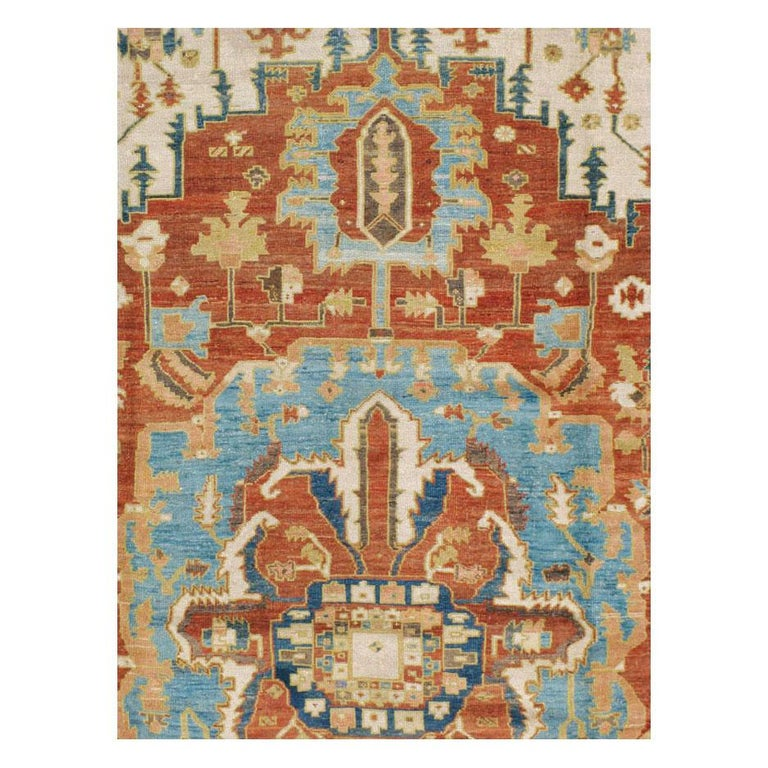 An antique Persian Serapi (grade term for higher quality Heriz rugs) large room size carpet handmade during the early 20th century.