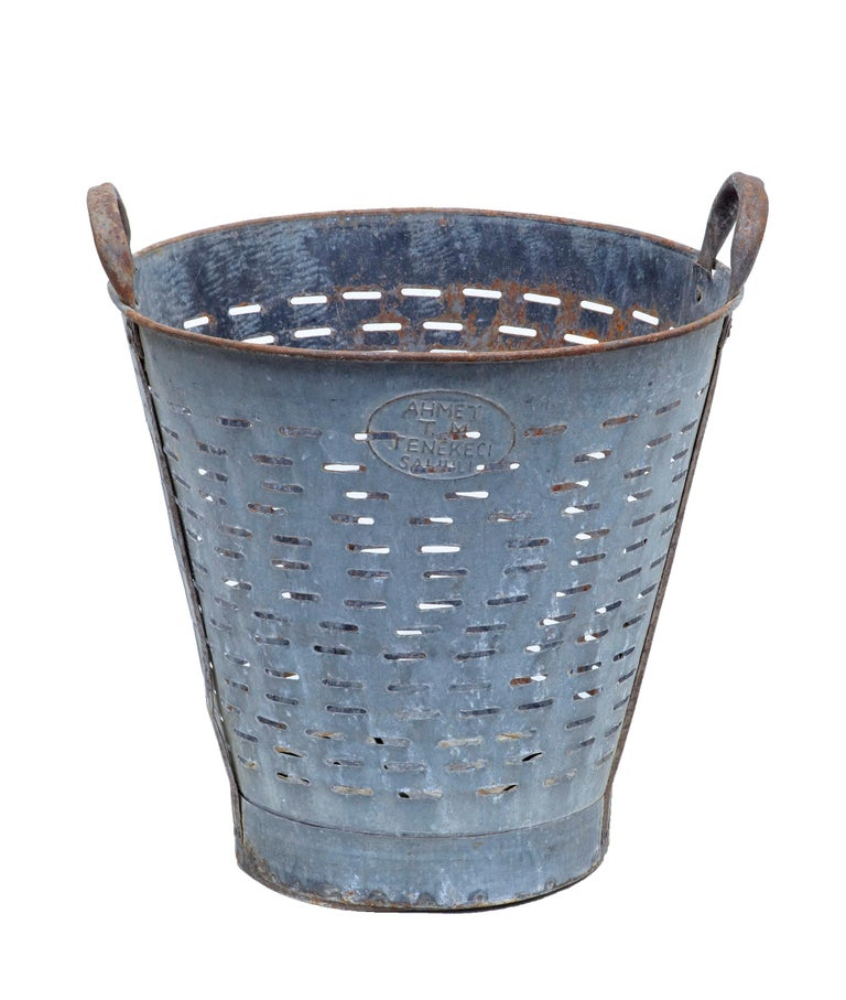 Early 20th century industrial metal basket, circa 1920.  Scandinavian fishing basket, with slotted sides and 2 carrying handles. Ideal for re-use as a waste paper basket or log bin.  Has taken on a desirable patina with mild rusting.