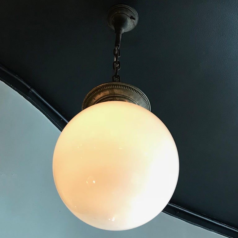 Brass Early 20th Century Industrial Milk Glass Globe Library Pendant Light For Sale