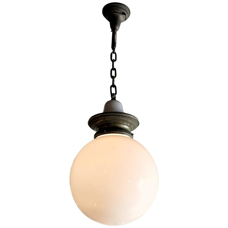 Early 20th Century Industrial Milk Glass Globe Library Pendant Light For Sale