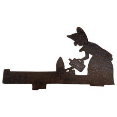 Early 20th Century Iron Folk Art Silhouette of a Woman Watering Her Bush
