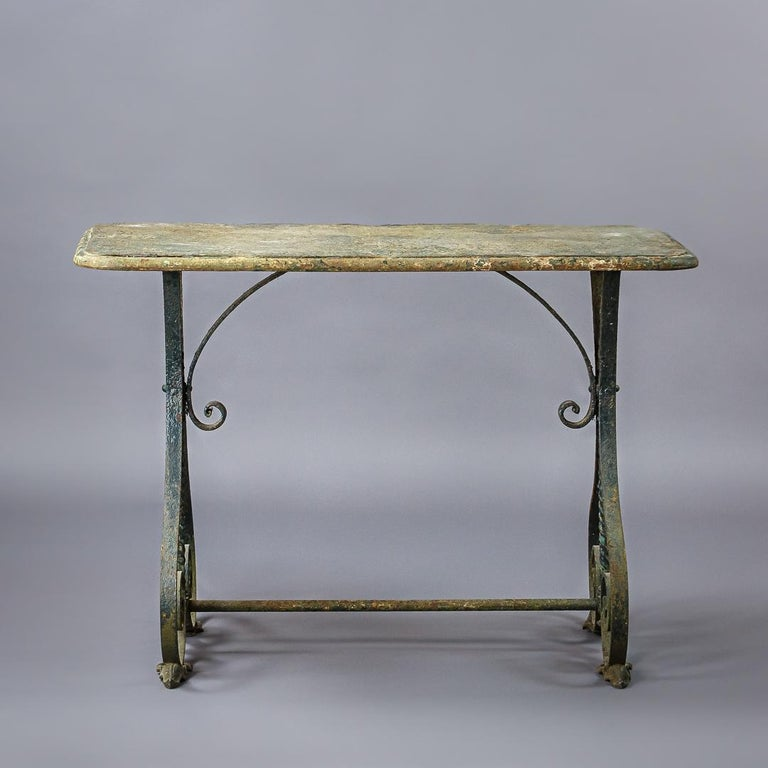 Wonderfully sculptural iron garden or conservatory table. Great patination to the surface. Some minor losses.