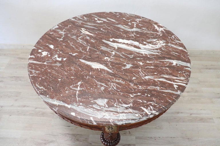 Hand-Carved Early 20th Century Italian Carved Walnut Round Center Table with Red Marble Top For Sale