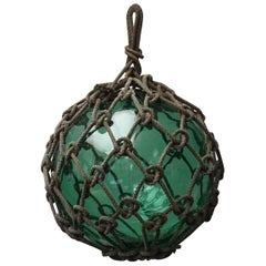 Early 20th Century Japanese Green Glass Fishing Float in Tied Knotted Ropes